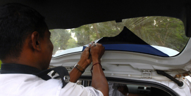 Goa Police removing tinted window film